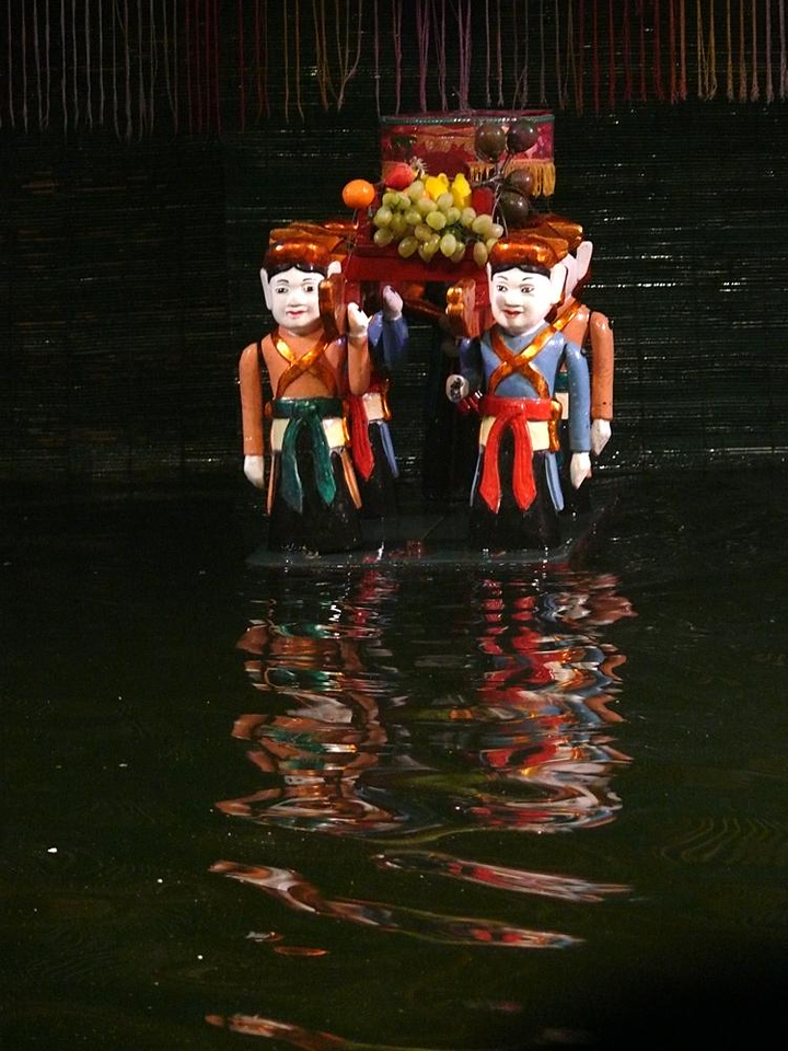 Water puppets, Hanoi - Water puppetry is one of the most authentic expressions of Vietnamese culture. Hiding backstage, puppeteers standing waist deep in water maneuver large wooden figures carved from fig trees. Backed by live music and song, the puppets tell stories of ancient warrior heroes, corrupt landlords, and cruel rulers.