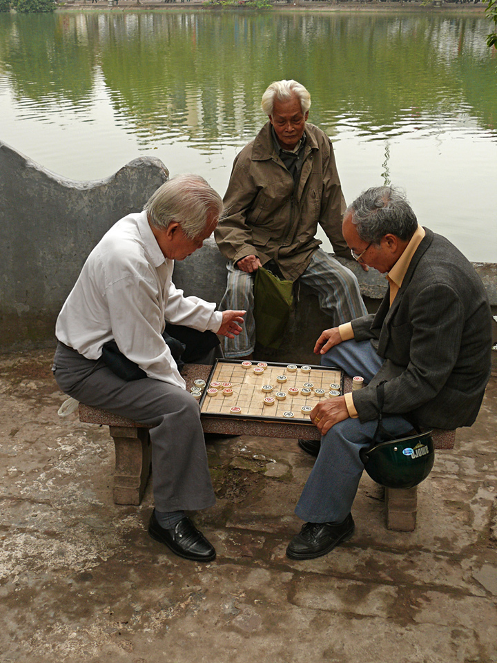 Mental exercise, Jade Mountain Temple - Hanoi residents enjoy board games outside this temple, which stands on a small island in Hoan Kiem Lake in the center of the city.