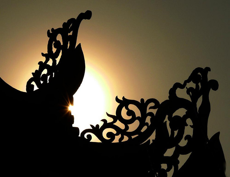 Radiance, Hoi An - A small temple next door to our hotel in Hoi An offered an elegant foreground for a setting sun.