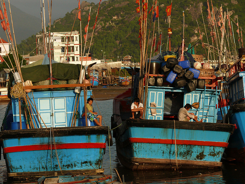 Fishing fleet, Nha Trang - While visiting this coastal city in central Vietnam, I made sure to visit its fishing fleet early in the morning. These boats and their young crews are getting ready to put out to sea.