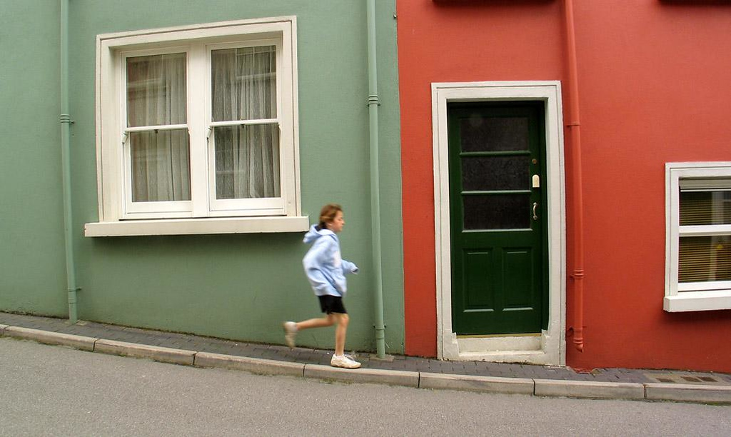 Fleet of foot on the hills of Kinsale - Kinsale's hilly streets provide a colorful backdrop for a young runner.
