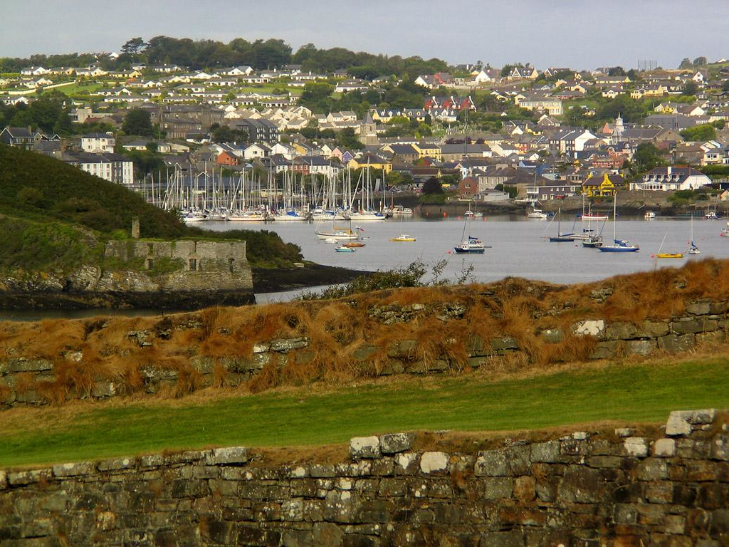 Kinsale, seen from Charles Fort - The old fishing village of Kinsale, Ireland, now draws yachts from all over Europe. Here the harbor is viewed from within the ruins of Charles Fort. The remnants of another fortress, James Fort, are at left.