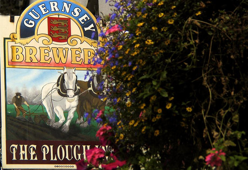The Plough Inn, St. Peters Port - This is one of many pubs that line St. Peters Port's ancient streets. The Plough Inn plays tribute to Guernsey's industrious farmers. The 64 square kilometer island exports flowers, fruits, tomatoes, and is noted for its Guernsey cattle.