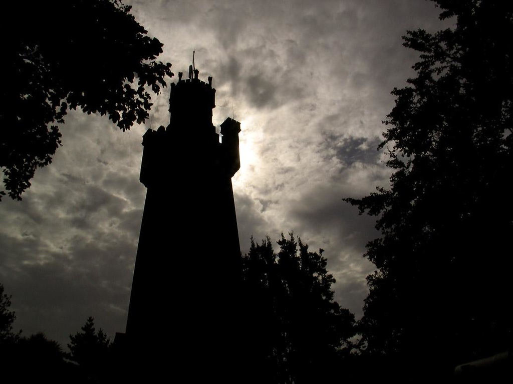 Victoria Tower, St Peters Port - The highest observation point on Guernsey is this Victorian tower, which in this backlighted photograph seems to represent a stern king wearing a crown and holding an authoritative arm upright.