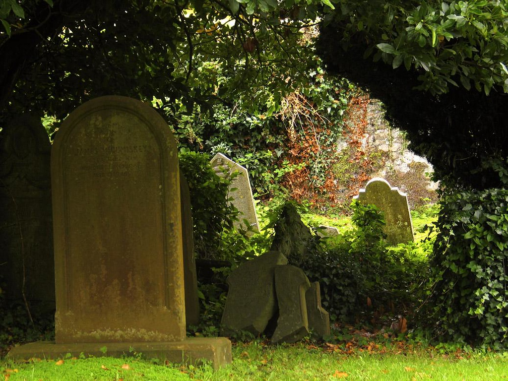 St Multrose Burial Ground, Kinsale - This small cemetery, standing next to a church that was nearly a thousand years old, seemed haunted. Its titled, cracked headstones bear names of families that still live in Kinsale.