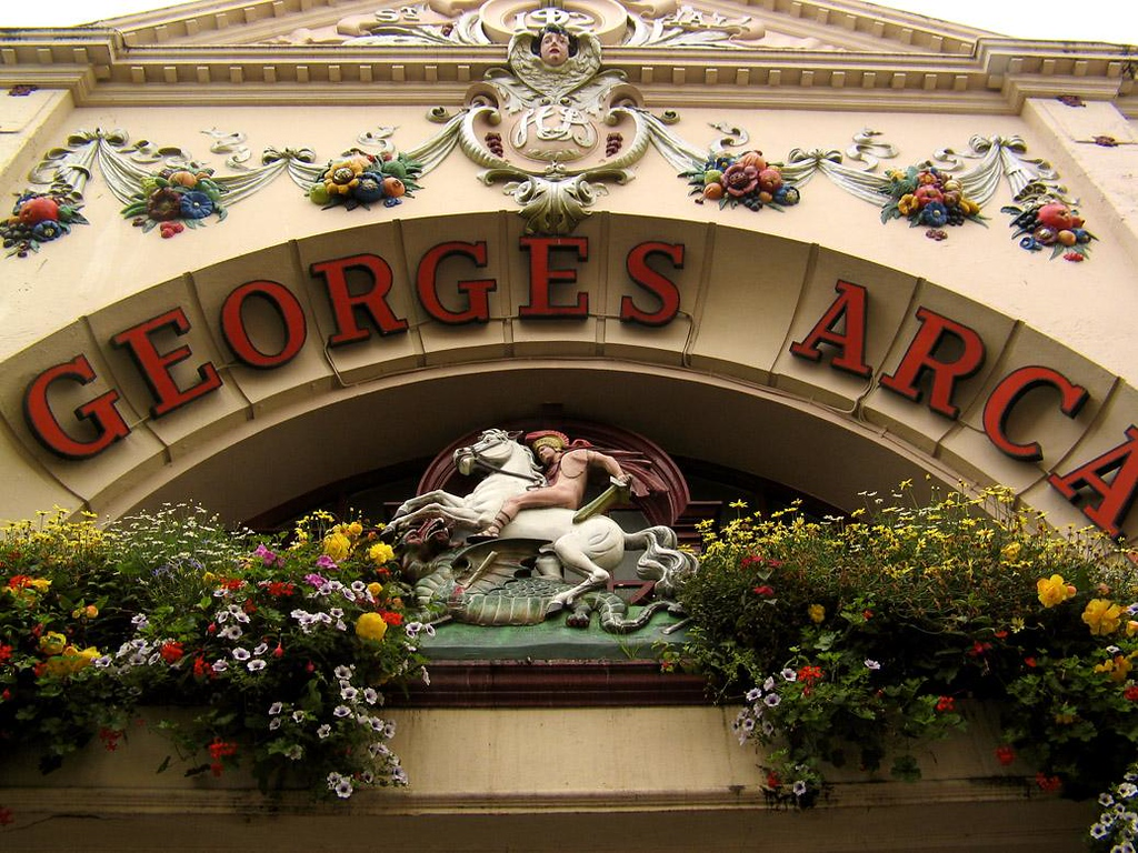 St. George's Arcade, Falmouth - St. George slays the dragon over the entrance to a colorful shopping mall bearing his name in downtown Falmouth.