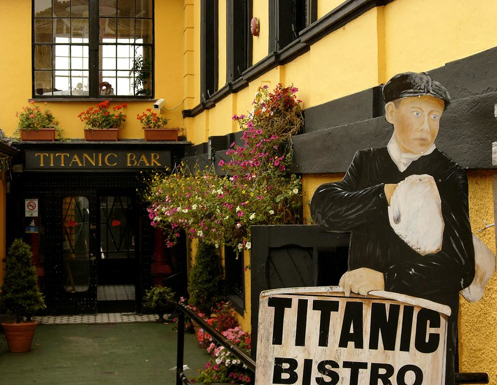 Cobh, last stop for the Titanic - Cobh was the last port the ill fated Titanic would ever see. In this yellow building, now home to a bistro, passengers checked in and then walked out the back door to board a tender which took them to the ship. Today an image of a newsboy bearing newspapers welcomes tourists to its front door.