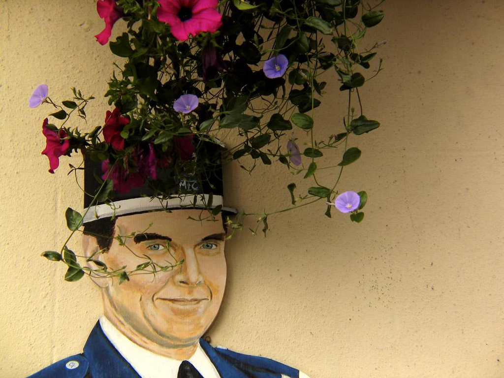 Flowery crown, St Peters Port, Guernsey - A French policeman (or soldier?) hiding behind a basket of flowers in a British town? Only one of a number of incongruous sights along the old streets of St. Peters Port.