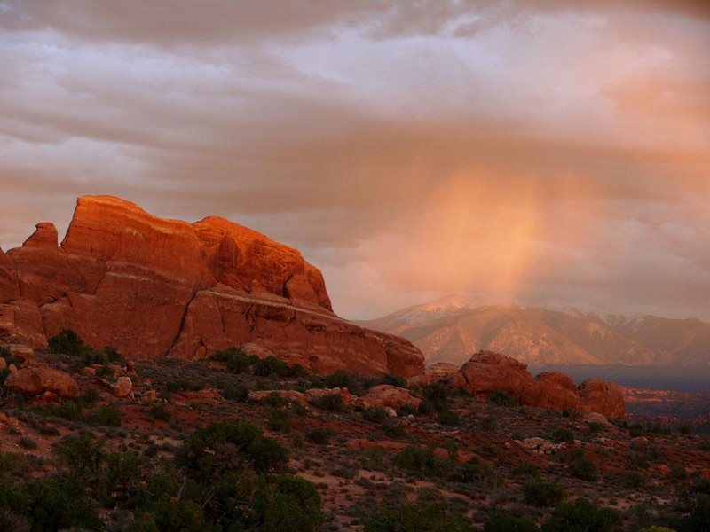 Golden rain at Arches National Park - A squall at sunset can be magical.