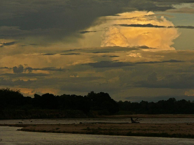 Luangwa Riverscape - Late afternoon on the Luangwa River. Spectacular cloud formations such as this are a photographic benefit of Zambia's wet season.