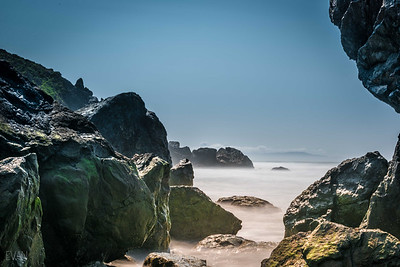 Stinson Beach rocks, long exposure and view of San Francisco