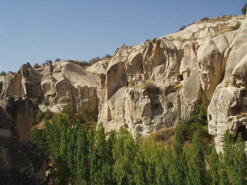 Cappadocia...  lots of holes in rocks; it is soft, volcanic rock.