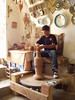Pottery making... he is learning; he was a very nice kid