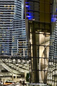 """I Love the Las Vegas City Center - such amazing architecture!  This is the Aria in the background with the west Veer Tower (and reflections) in the forefront.  (View enlarged) The shape in the forefront - which looks to me like a CD-  is a mud drawing on the lobby wall of the Veer Residential Tower.  Its so unique!  The art by Richard Long of Bristol England, was created with paint diluted with mud  & applied to the walls with his hands.  This drawing on the west tower is the """"Circle of Chance"""" - the mud was brought to Las Vegas from the River Avon which runs through Long's home down in England.  I want to go back just to see the fabulous art at the City Center."""