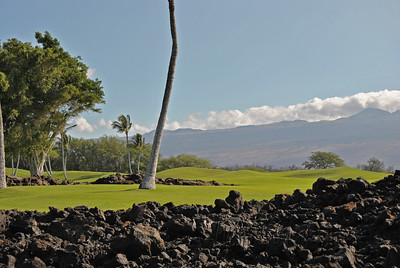 Beautiful landscape with lava chunks amidst the green of the golf course