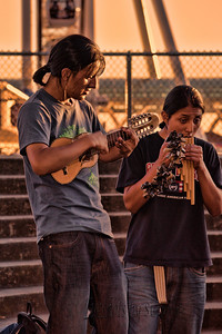 Street Performers at Seattle Waterfront The lighting was beautiful, the wooden flutes lovely - but I had no idea what the small guitar was.  Its called a Guitalele - a hybrid, cross between a classical guitar and a tenor ukulele!