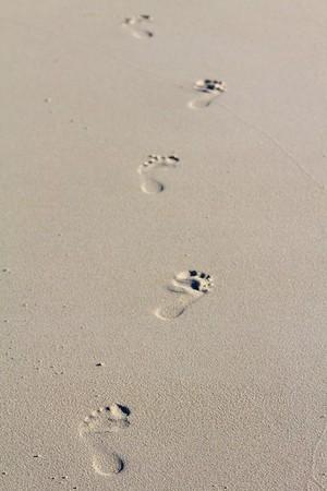 Foot prints in the sand Injidup beach