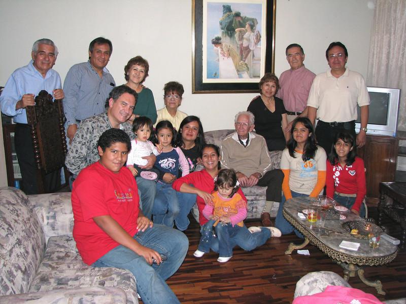 Cousins, aunts, uncles...  lots of family.<br /> Primos, tios, tias...  mucha familia.