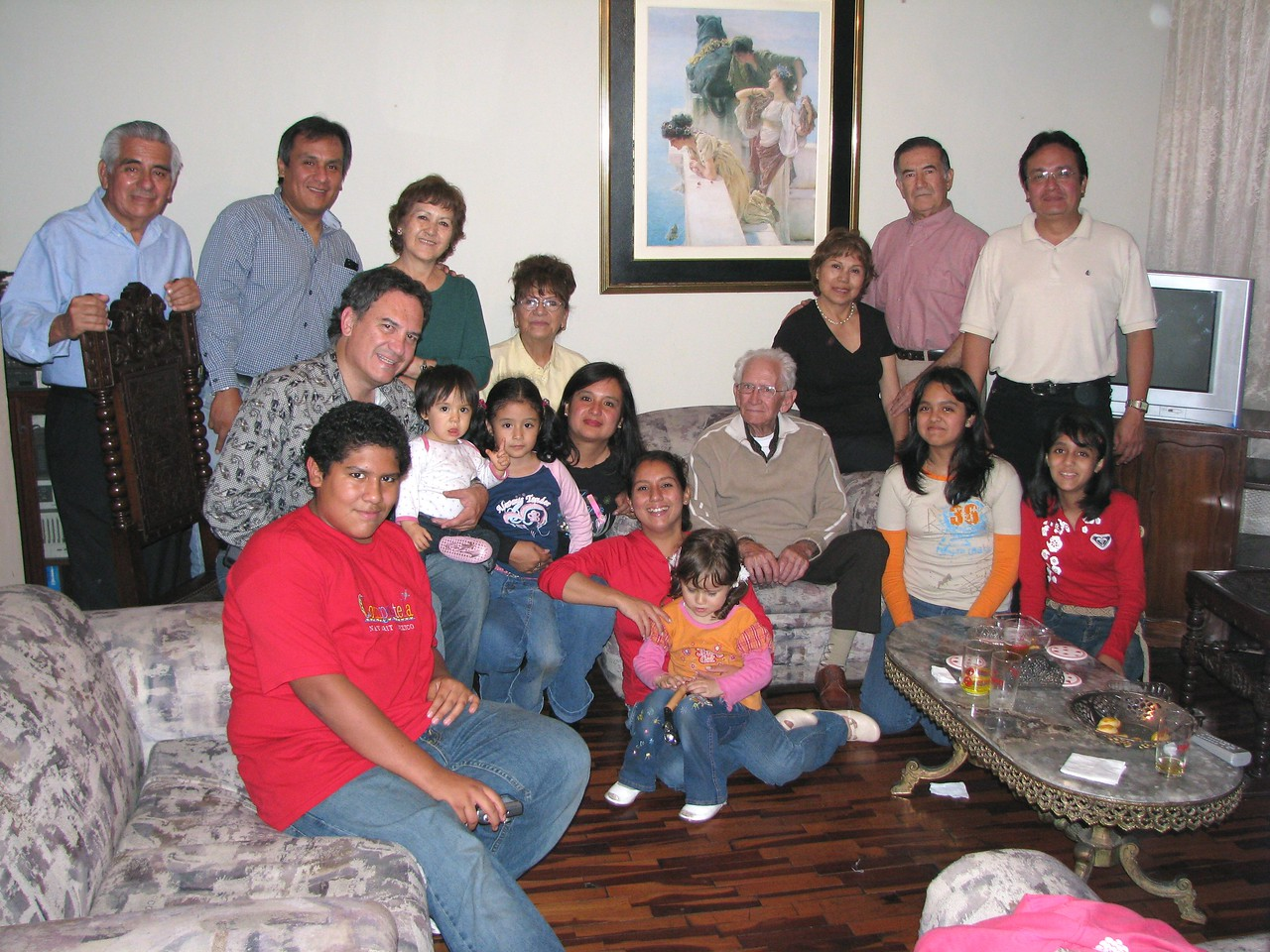 Cousins, aunts, uncles...  lots of family.<br /> Primos, tios, tias...  mucha familia.