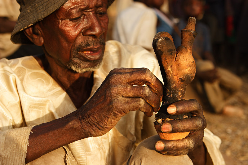 An old man creating a mold from clay, Amsa, Extreme-North, Cameroon.