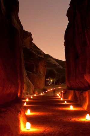 "Narrow path called ""Siqh"" illuminated by candles. Petra, Jordan."