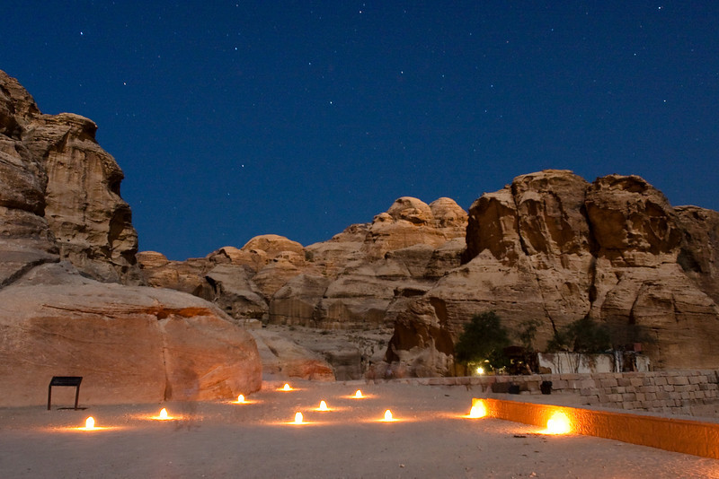 "Entrance of the Narrow path called ""Siqh"" illuminated by candles. Petra, Jordan."