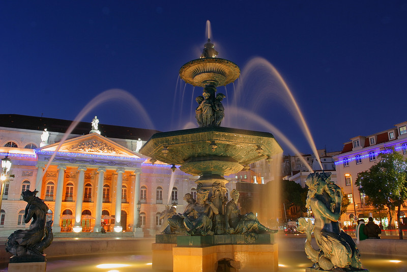 Teatro Nacional Dona Maria II and a fountain from the Rossio square, Lisboa, Portugal.