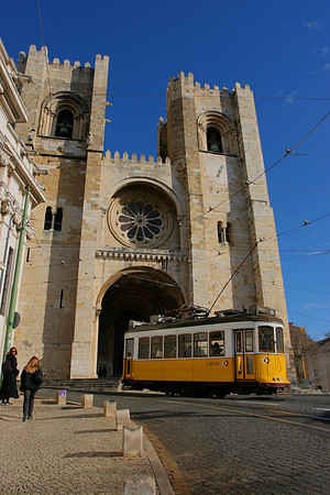 Tramway cose to a cathedral, Lisboa, Portugal.