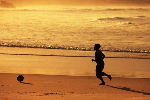 Soccer player at the praia de Toffo, Mozambique.