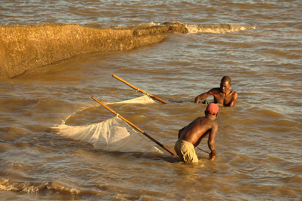 Fishermen from Beira at sunrise, Mozambique.