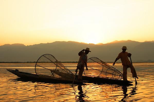Graceful Inthas fishermen, Inle lake, Myanmar at sunrise.