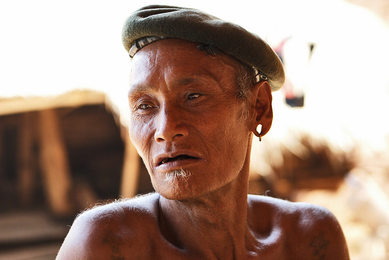 An old chief from an Eng tribe in the hills close to the Thai border, Golden triangle, Myanmar.