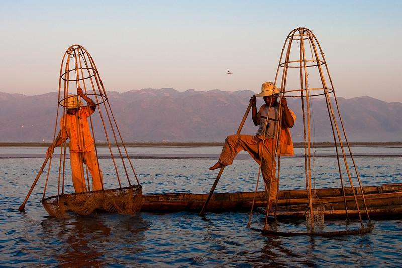 Graceful Inthas fishermen, Inle lake, Myanmar.