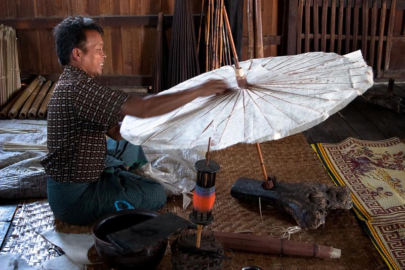 A nice family preparing paper umbrellas, Inle lake, Myanmar.