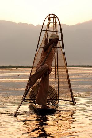 Graceful Intha fisherman, Inle lake, Myanmar at sunrise.