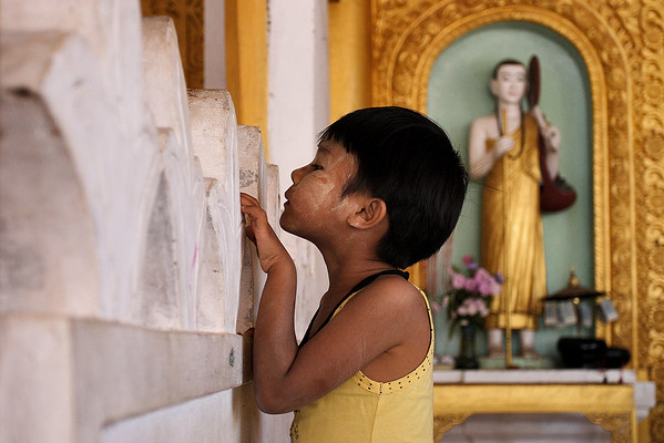 Girl with Tanakha on her face during a Buddhist festival at the Aludabang pagoda, Inle lake.