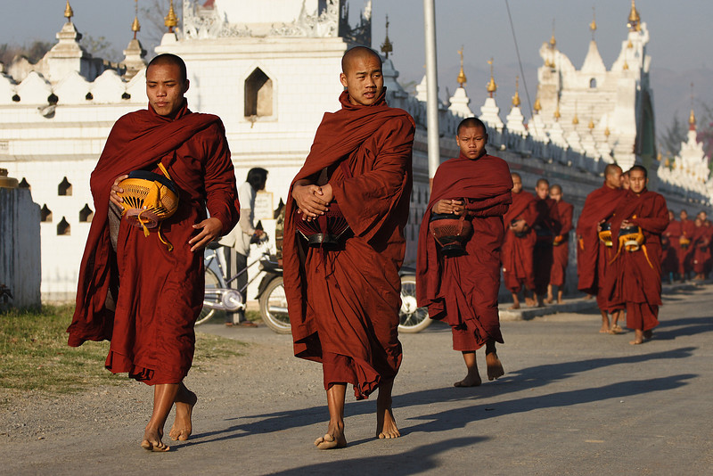 Morning procession. Monks are getting some food from local people. Nyaung Shwe, Myanmar.
