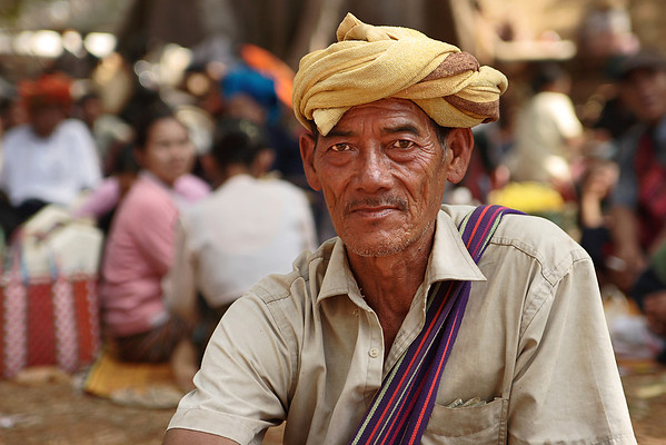 Man wearing the traditional dragon-shaped hat from Pa-O tribes, Myanmar.