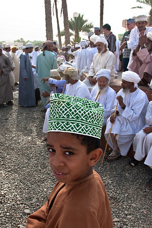 Omani kid from the Nizwa market close to the fortress, Sultanate of Oman.