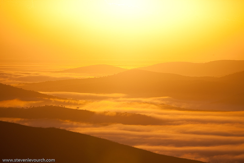 Sunrise over the clouds in the Hluhluwe reserve, Kuazulu Natal Province, South Africa.