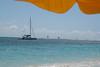 Tiko Tiko with colorful sails on the horizon
