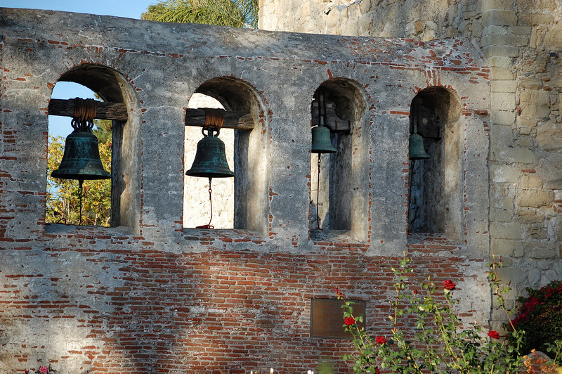 """""""Campanario, or Bell Wall""""<br /> <br /> <br /> """"How many bells does the San Juan Capistrano mission have?<br /> <br /> The Great Stone Church of San Juan Capistrano had bells hung in the tower. When the church collapsed in a massive earthquake, in 1812, the four original bells survived and were hung in a bell wall the following year. The two largest bells were cast in 1796, the others in 1804.<br /> <br /> In 2000 the bells were removed from the bell wall and used for molds to make copies. They were saved after the copies were made, and placed in their current location in 2004. The two large bells on display within the Great Stone Church are now the original bells. The large bells in the bell wall are copies.""""<br /> 5/31/2010 - <a href=""""http://www.missionscalifornia.com/ate/how-many-bells-does-san-juan-capistrano-mission-have"""">http://www.missionscalifornia.com/ate/how-many-bells-does-san-juan-capistrano-mission-have</a>"""