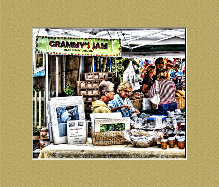 """September 2, 2009 - """"Jam or Photos""""<br /> <br /> Looks like Grammy also has a photo business going here at the Saturday Farmers Market.    The print under Carole Anne says AKA """"Grammy"""" of Grammy's Jam.<br /> <br /> Since this photo includes a framed photo, I thought I would spend the money and add a frame to the image :)"""