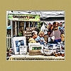 "September 2, 2009 - ""Jam or Photos""<br /> <br /> Looks like Grammy also has a photo business going here at the Saturday Farmers Market.    The print under Carole Anne says AKA ""Grammy"" of Grammy's Jam.<br /> <br /> Since this photo includes a framed photo, I thought I would spend the money and add a frame to the image :)"