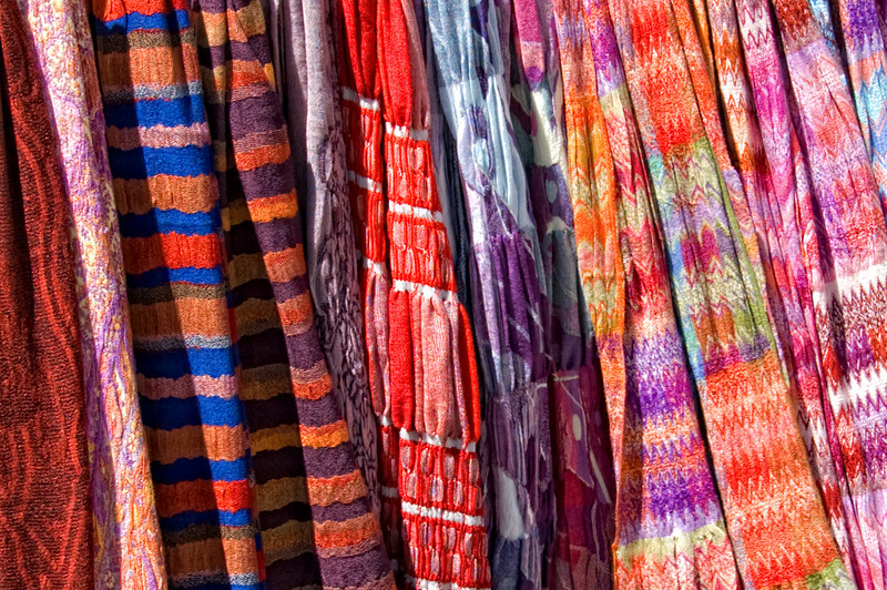 """Scarves or Scarfs""<br /> <br /> Colorful scarf vendor booth at the Farmers Market in Minturn, Colorado."