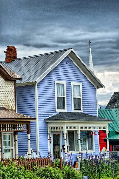 """""""Leadville Victorian Era""""<br /> <br /> The house was the subject of the shot, but the distracting steeple was more interesting to write something about. The spire of the Annunciation (Catholic) Church is in the background. This Leadville, Colorado church was built in 1879. The famous """"Unsinkable Molly Brown"""" was married in the church on September 1, 1886.<br /> <br /> <br /> from Wikipedia, the free encyclopedia<br /> <br /> Margaret Brown (née Tobin) (July 18, 1867 – October 26, 1932), more widely known as Maggie Brown, Molly Brown, or Unsinkable Molly Brown, was an American socialite, philanthropist, and activist who became famous in the 1912 sinking of the RMS Titanic, after getting lifeboat 6 to return to look for survivors and as leader of the women survivors. She became known after her death as The Unsinkable Molly Brown, although she was not called Molly during her life. Her friends called her Maggie.<br /> <br /> In 1960, the Broadway musical The Unsinkable Molly Brown opened with Tammy Grimes, who won a Tony Award for her performance.<br /> Margaret was portrayed by Debbie Reynolds in the 1964 film version of the stage musical The Unsinkable Molly Brown, which brought Reynolds her only Oscar nomination. Marilu Henner played Margaret in a 1996 made-for-TV miniseries, and Kathy Bates played her in the 1997 film Titanic."""