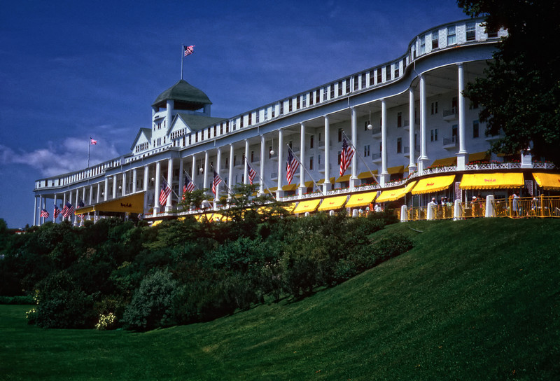 """""""Grand Hotel - Mackinac Island""""<br /> <br /> From Wikipedia, the free encyclopedia<br /> The Grand Hotel is a historic lodging facility located on Mackinac Island, Michigan, a small island located at the eastern end of the Straits of Mackinac within Lake Huron between the state's Upper and Lower Peninsulas. Constructed in the late 19th century, the facility advertises itself as having the world's largest porch. The Grand Hotel is well known for a number of notable visitors, including five U.S. presidents, inventor Thomas Edison, and author Mark Twain."""