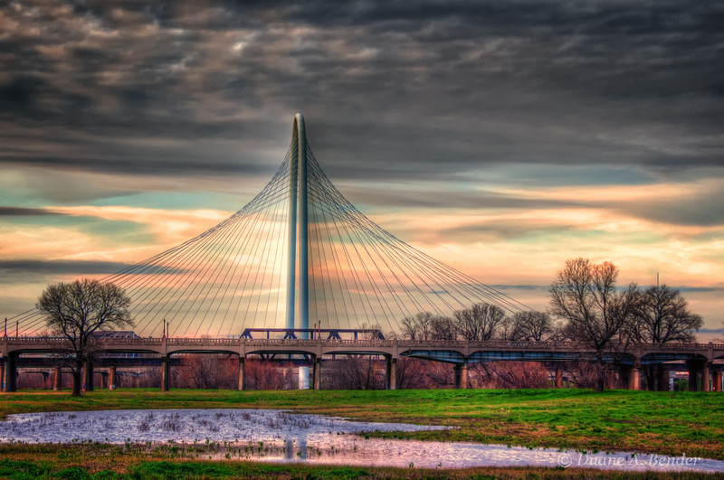 "February 5, 2012 - ""Trinity River Crossings""<br /> <br /> The middle bridge is the 80 year old Santa Fe Trestle Bridge that has been re-purposed as a hike and bike path  as part of the Trinity River Redevelopment in Dallas.  The suspension bridge in the far distance is scheduled for ribbon cutting on March 4.<br /> <br /> This was shot roughly 90 degrees to the left of the camera position from where yesterdays Dallas Skyline image was shot."