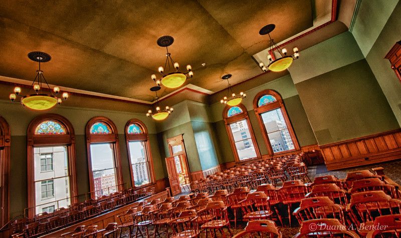 The courtroom has been restored to Nineteenth Century appearance.  Over 100 stained glass windows, or lunettes originally hung on the upper floors.  Those saved and reproductions now are in various windows.