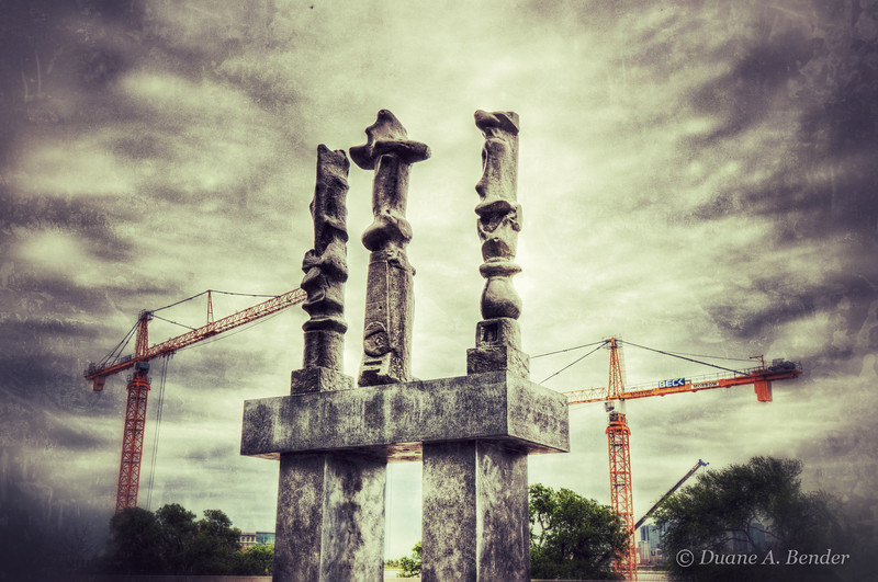 """March 25, 2012 - """"Standing Tall""""<br /> <br /> - an ancient icon stands its ground in the path of progress<br /> <br /> (just kidding - statue art is in front of the Amon Carter Museum facing construction work expanding the Kimbell Art Museum in Ft. Worth)"""